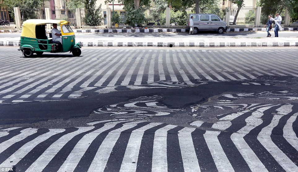 Temperature in New Delhi continues to hover near 45 degrees Celsius that it makes the road melts