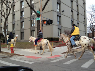 Three men riding horses in Southwest Detroit