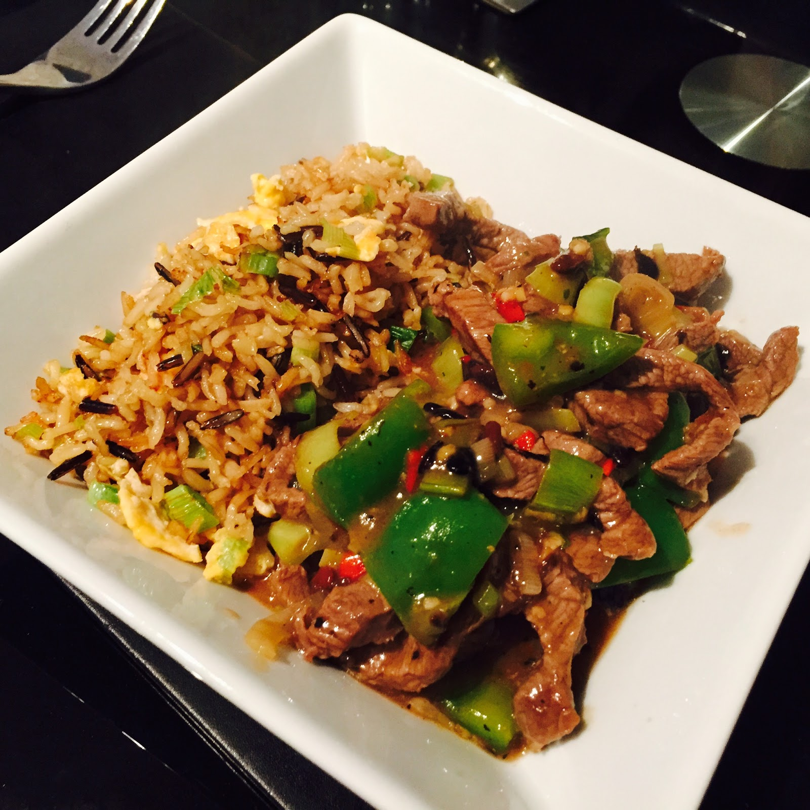 Beef and green peppers with black bean sauce and egg fried r..