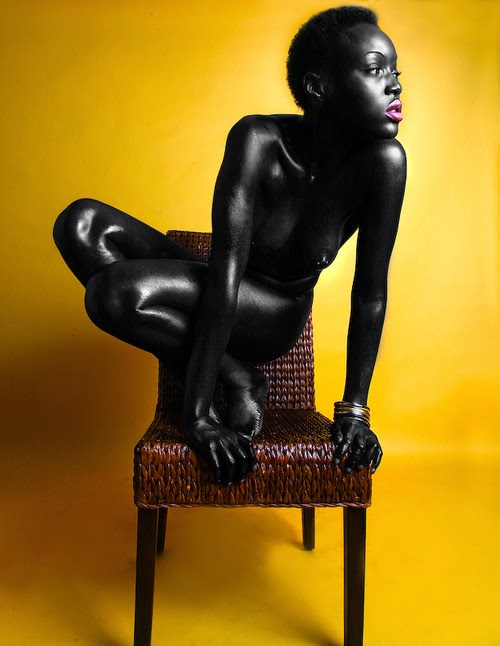 Folasade on a chair.