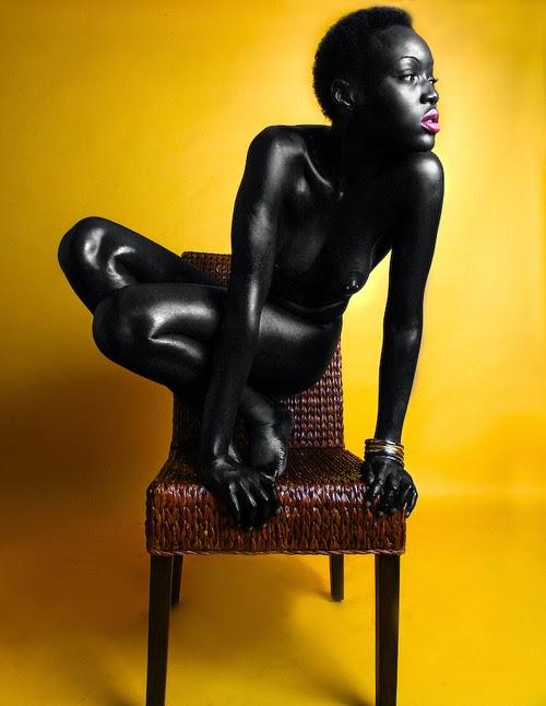 Folasade on a chair.