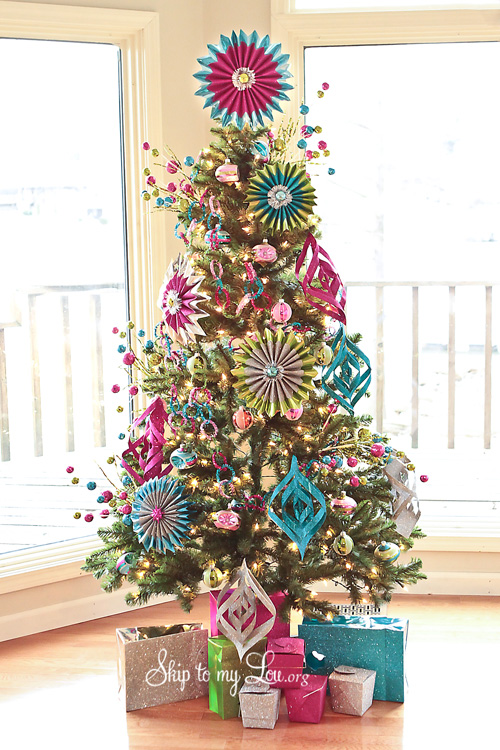 they use actual decorations or if they are ornaments they are over the top huge also decorating the base of your tree can really make a huge difference as