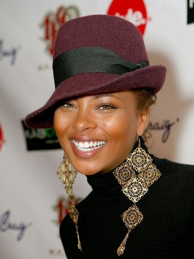 Eva Marcille wearing gold filigree earrings by Jenny Dayco