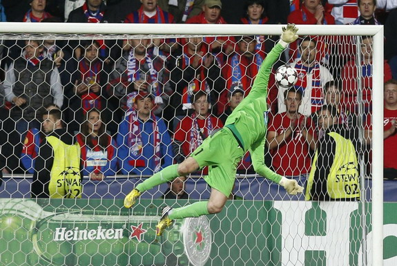 Viktoria Plzeň goalkeeper Matúš Kozáčik is unable to save a goal from Manchester City's Yaya Touré
