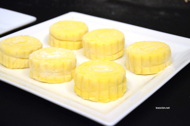 "Freshly made by the chef, our mini ""red prawn"" durian mooncakes"
