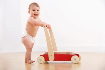 أسباب تأخر المشى لدى الأطفال...وطرق علاجه - baby walking toy help aid  - أهمية الكالسيوم فى حالات تأخر المشى لدى الأطفال