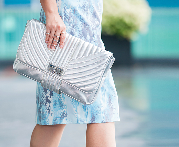 Crystal Phuong carries Raoul silver clutch and finished with white gold midi rings.