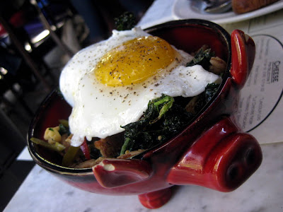 Pig&#8217;s Ear with Crispy Kale, Pickled Cherry Peppers, and Fried Egg at The Purple Pig in Chicago - Photo by Michelle Judd of Taste As You Go