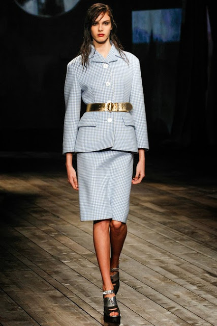 Model from Prada's Fall 2013 runway show wearing a blue and white gingham suit