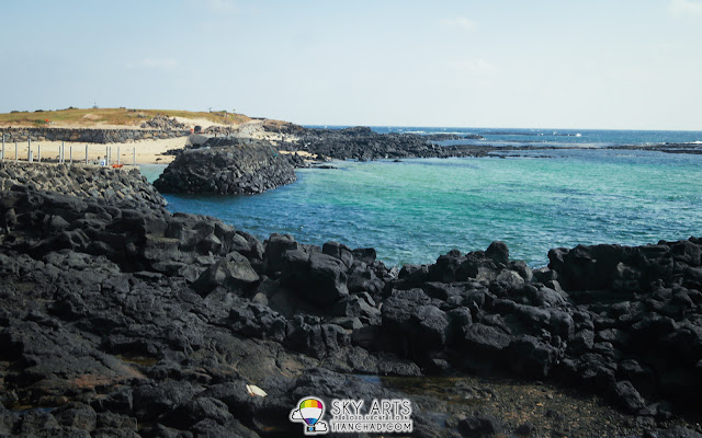 Black beach, blue seas in different layers - Udo Island