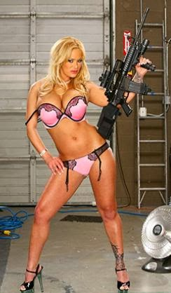 Blonde girl in lingerie with a gun
