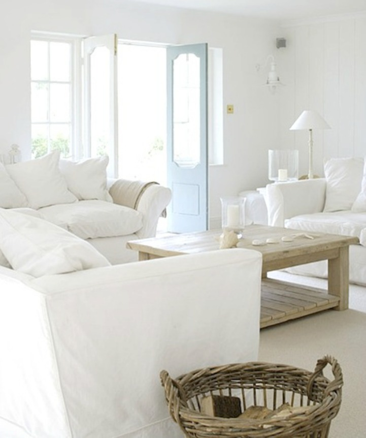 Coastal white slipcover sofa in a shabby chic beach house