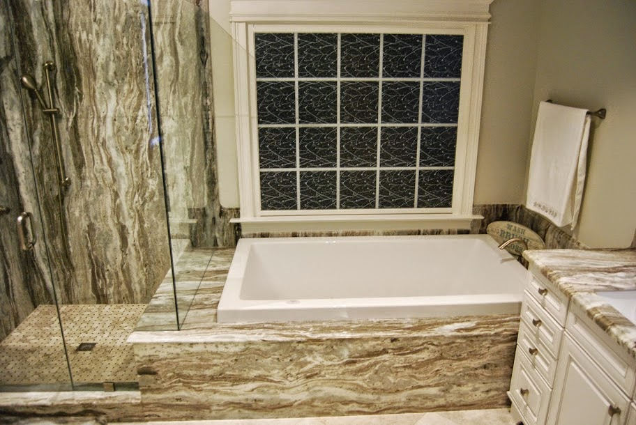 having a backsplash around the tub area protects the wall from water