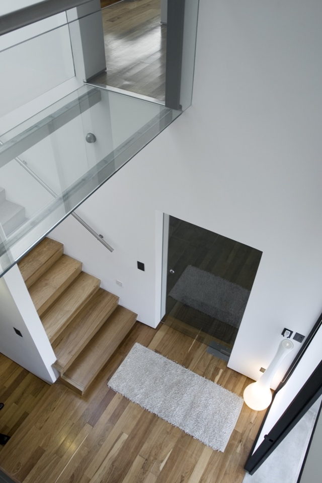 Wooden staircase and bridge with glass floor