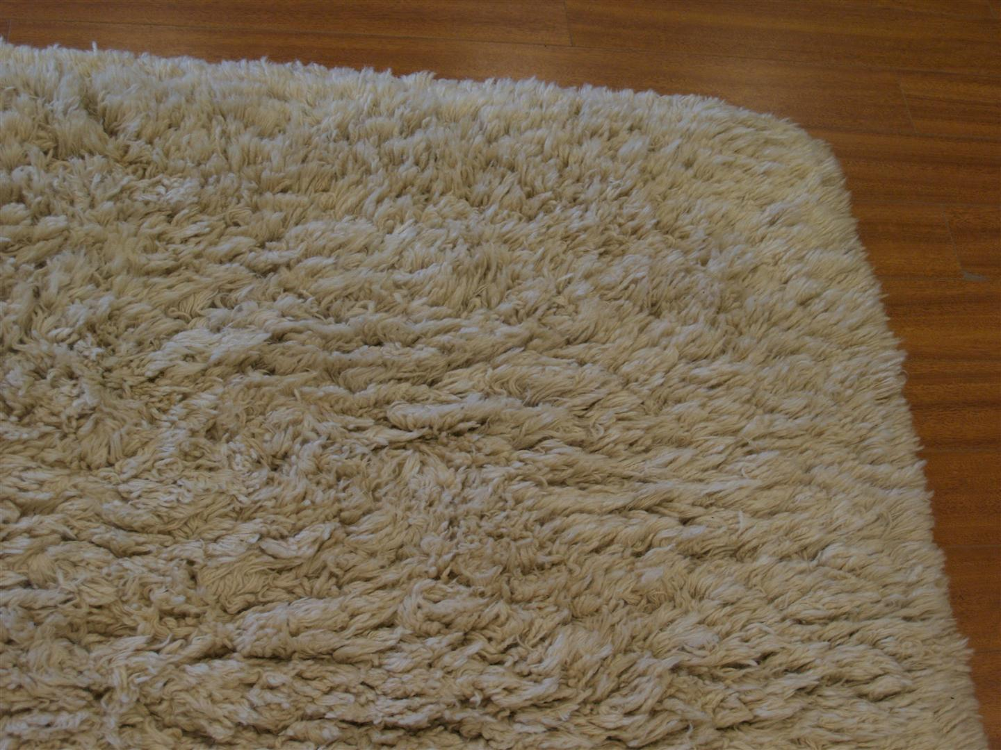 This shag rug looks great now and is the original ivory color. The entire  pile has been cleaned and it is now ready to be placed down in the