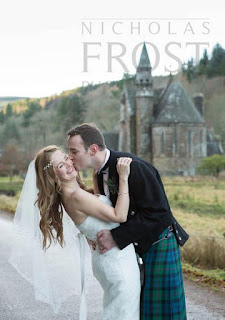 Bride and groom embracing outside a Scottish Castle