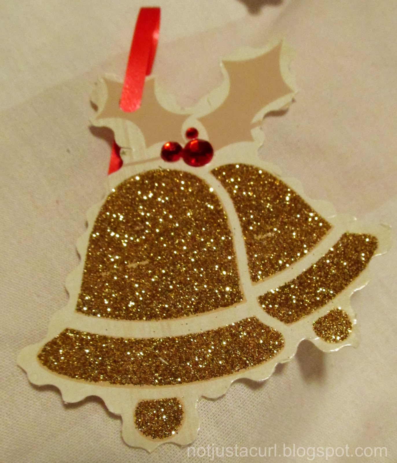 A photo of a Christmas bell gift-tag