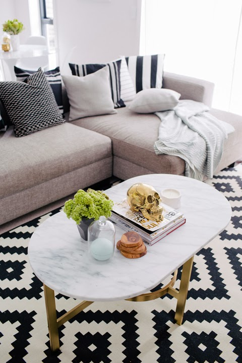 Living room with bold black and white graphic print rug
