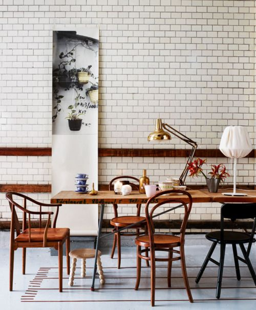 Curvy+wooden+chairs+in+dining+room+with+white+subway+tiles+via+littlebluedeer.com