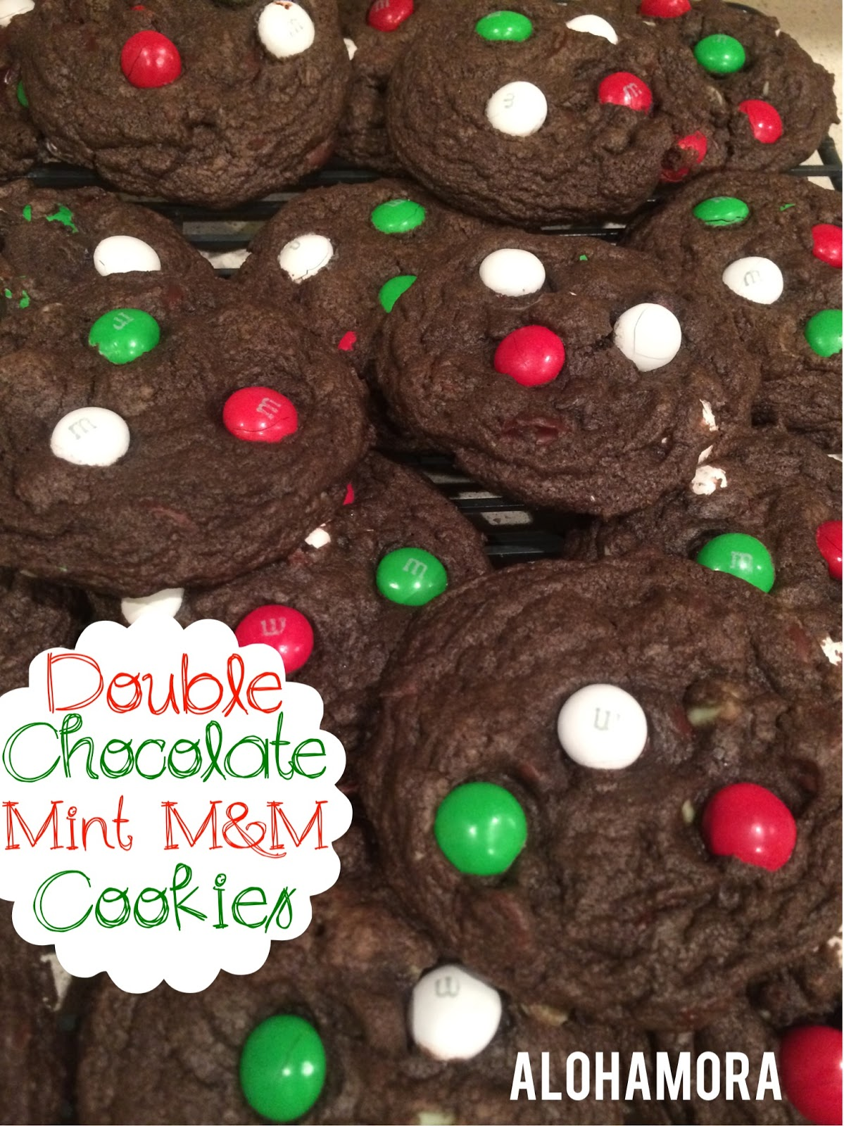 Double Chocolate and Double Mint Cookies with Mint M&M candies.  Deliciously chocolate cookies that are soft and big and absolutely delicious!  Perfect cookie for a chocolate/mint lover.  Use the Christmas M&Ms for a festive Holiday cookie perfect for a cookie exchange or neighbor gifts.  Alohamora Open a Book http://alohamoraopenabook.blogspot.com/