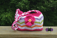 http://www.ravelry.com/patterns/library/rolling-waves-purse