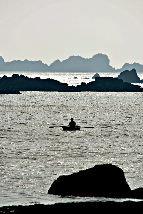 Man in rowing boat Isles of Scilly