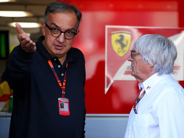 Marchionne engaging in discussion with Ecclestone at Monza in 2015.Source:Getty Images