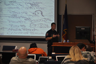 Huntsville ISD Officer Everett Harrell shows gang doodling in a student's notebook.