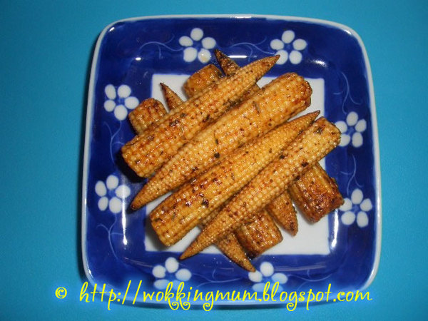 Lets get wokking buttered baby corn singapore food my sons most current favourite dish super simple i still dont quite understand why he likes this soooo much he can finish the whole pack of baby corn forumfinder Choice Image