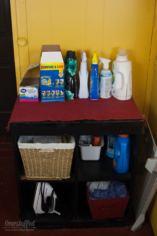 A functional laundry room always has a place to put supplies.