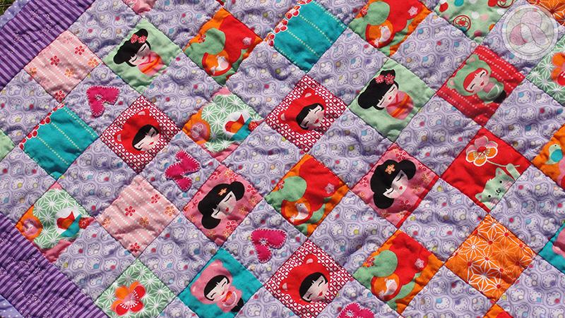Colcha de cuna de patchwork con la técnica patch de 9