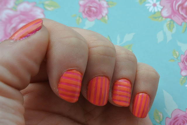 pink and orange striped nail swatch