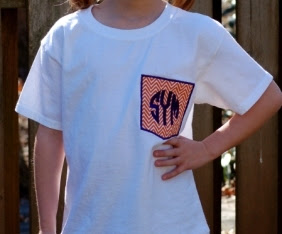 http://honeybeelanedesigns.com/item_169/Small-Orange-Chevron-Monogrammed-Pocket-T-shirt.htm