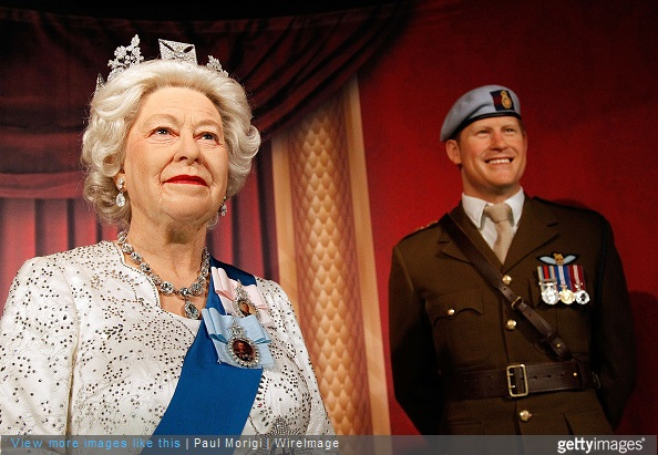 Wax figures of British Royal Family members Queen Elizabeth II and Prince Harry are unveiled at Madame Tussauds on May 5, 2015 in Washington, DC