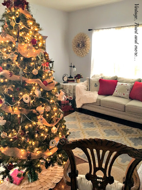 simple decor of red and gold in a neutral living room