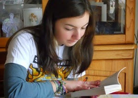 A girl enjoying her studies.