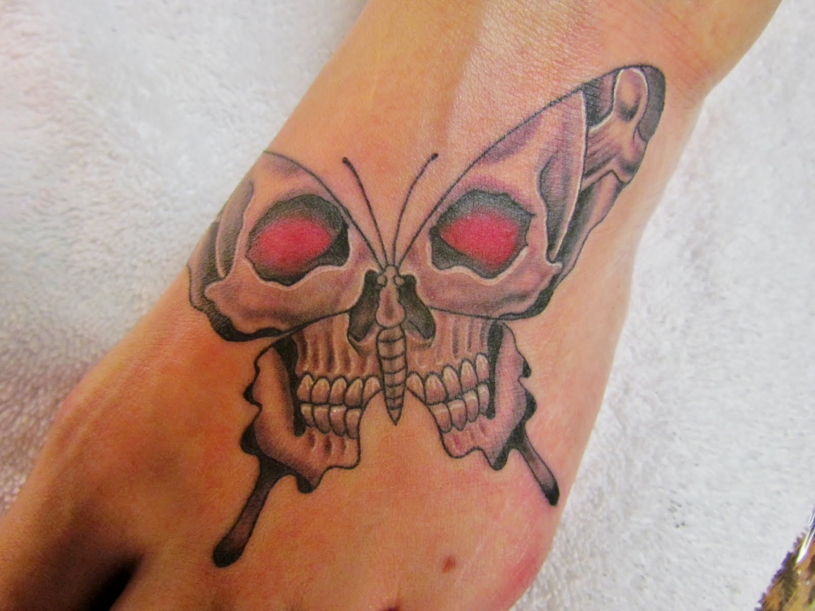 Skull Butterfly Tattoo Design Is A Hybrid Of Symbols While Butterflies