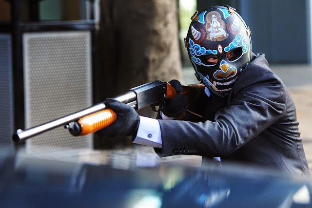That Demon Within 魔警 2014 movie still - Nick Cheung as Hon Kong robber with demon mask