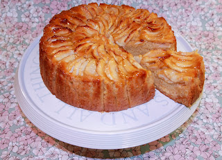 Apple and custard cake on a cake stand
