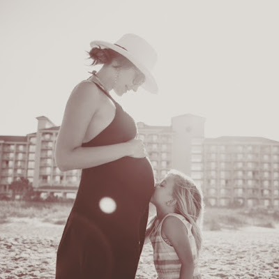 Amy West maternity portrait with daughter on the beach in Amelia Island