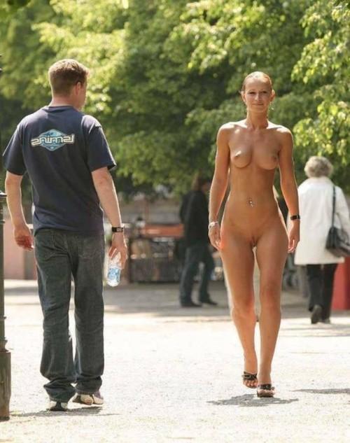 woman hand cuffed on knees blow job