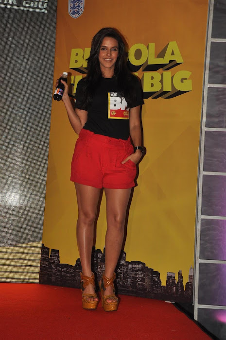neha dhupia at the new logo launch of cola brand big cola. hot photoshoot