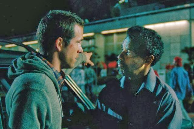 Ryan Reynolds y Denzel Washington en la película, El Invitado