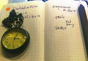 Bodegón con Moleskine, lápiz y reloj