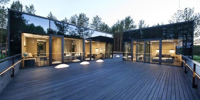 Casas minimalistas y modernas casa minimalista en medio for Casa minimalista en