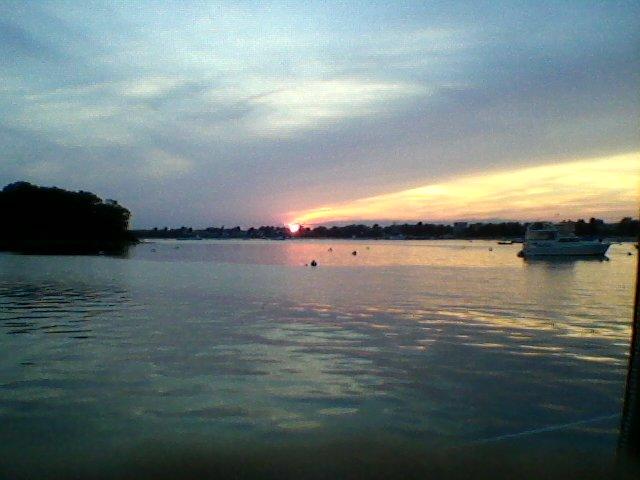 Long shadows, quiet, glistening waters