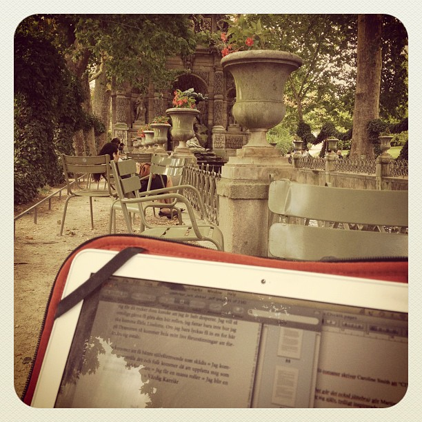 studying by the medici fountain in jardin du luxembourg, paris