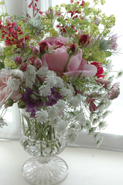 Roses, ammi majus, nigella and astrantia in a vintage glass vase. By Tuckshop Flowers