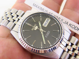 SEIKO 5 BLACK DIAL FLUTED BEZEL - AUTOMATIC 7S26