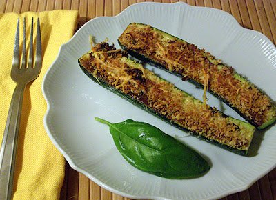 Two Parmesan Crusted Zucchini Halves on a Plate